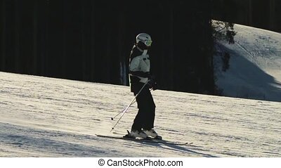 Skier rides on the ski track. Slow motion - The man on skis...
