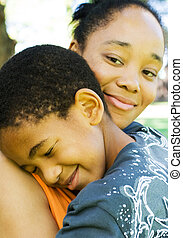 family love - an african american mother and son happily...