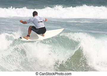 A surfer performs a floater on a closeout.