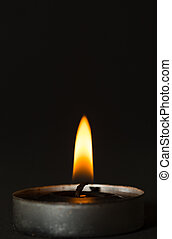 Black candle with black background