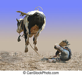 The Rear View - Cowboy Falling of a Bucking Bull isolated...