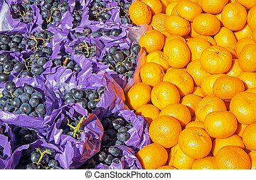 Clementines and grapes for sale