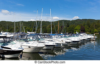 Cabin cruiser boats row on lake - Cabin cruiser boats in a...