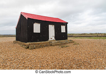 Black wooden shed, once used as Master TARDIS. - Black...