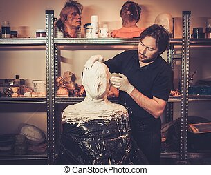 Men during lifecasting process in a prosthetic special fx...