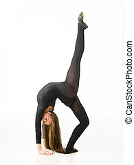 beauty of dance - female gymnast standing in bridge pose and...