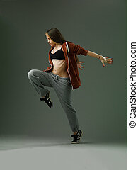 street dance - beautiful woman performing modern style dance...