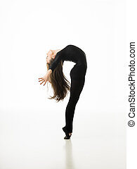 greatness - young beautiful dancer posing on white studio...