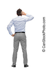 businessman scratching his head from back - business,...
