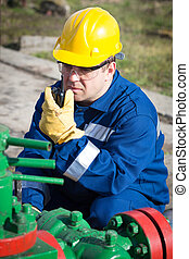 Worker on the oil field Refinery, oil and gas