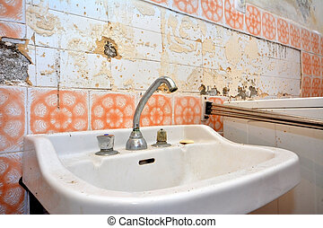 old lavatory in destroyed bathroom - old lavatory in rotten...