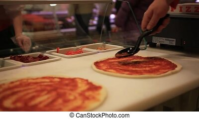 Fresh original Italian raw pizza, dough preparation in...