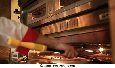 chefs Hands Ready pizza getting from oven Close up HD...
