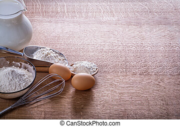 organized copyspace eggs corolla flour in spoon scoop bowl pitch