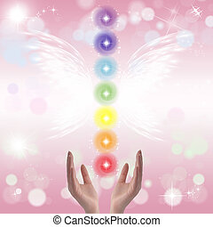Healing Hands and seven chakras on a sparklingpastel...