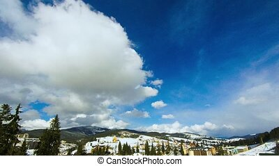 Clouds moving over the top of the mountain. Timelapse -...
