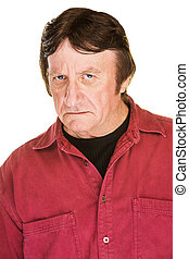 Frowning Mature Man - Suspicious man in red frowning over...