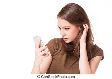 On the phone. - Portrait of gorgeous young brunette woman on...