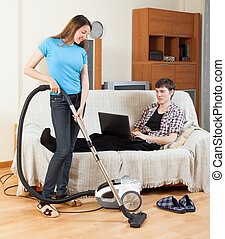 Girl cleaning at home - Girl cleaning with vaccuumcleaner at...