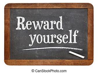 Reward yourself - motivational words on a vintage slate...