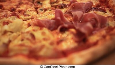 Pizza with cheese, ham and jalapeno pepper. Close up of...