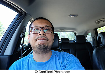 irritable man driving a car without seat belts