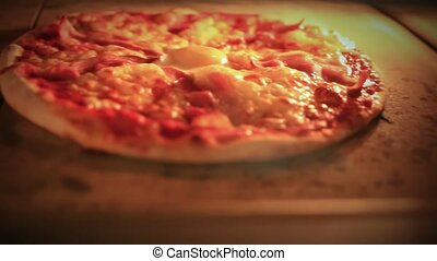 Pizza baking in traditional oven