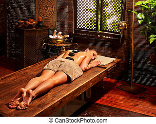 Woman having Ayurvedic stone massage - Young woman having...