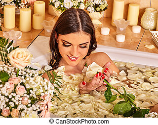 Woman at luxury spa. - Woman relaxing at flower water spa....