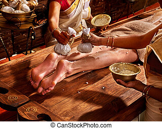 Woman having Ayurvedic feet spa massage. - Young woman...