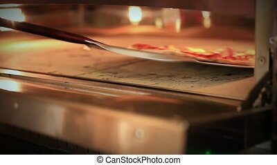 Ready pizza getting from oven and close Oven. HD. 1920x1080...