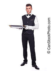 Young person in a suit holding an empty tray isolated on white b