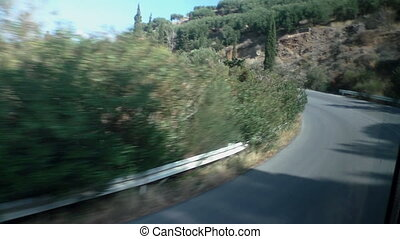 Road in the mountains - Windscreen view of moving bus on...