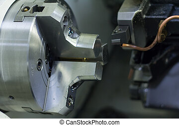 CNC Lathe Machining & CNC Turning Lathe Machine In low light...