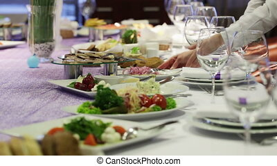 Serving table - Waiter serves a festive table