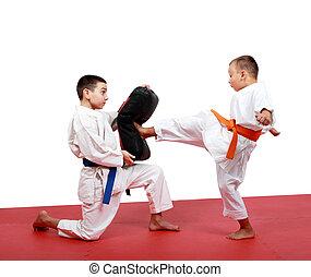 Boy in a kimono hits foot