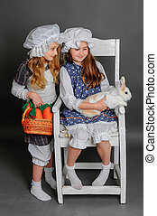 laughing girl in a rustic style with the Easter bunny,...