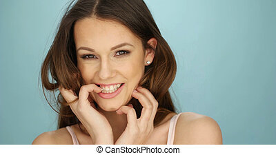 Gorgeous laughing playful young woman with a beaming smile...