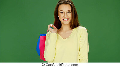 Happy female shopper carrying her purchases - Happy...
