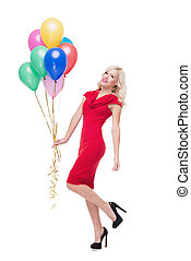 Smiling blonde woman with ballons isolated on white - Photo...
