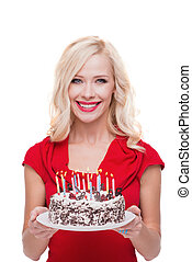 Smiling blonde woman with cake isolated on white