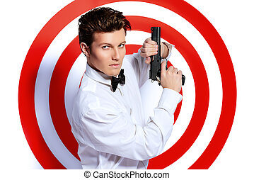 danger - Elegant handsome man secret agent with a gun posing...