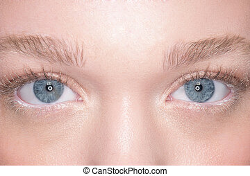 Lovely blue eyes of a young woman
