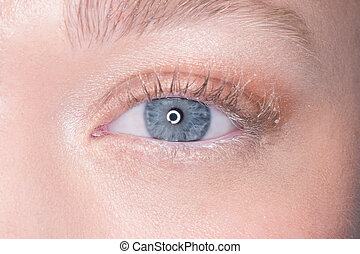 Lovely blue eye of a young woman