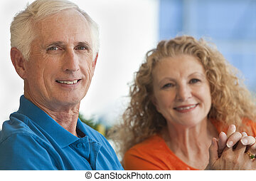 Senior Man and Woman Couple Holding Hands