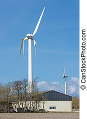 Wind turbine with broken wings after a storm in the...