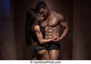 Romantic Bodybuilding Couple Against Wooden Wall - Portrait...