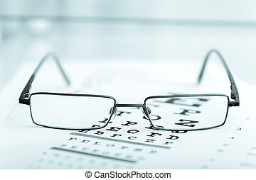 Clear Black modern glasses on a eye sight test chart
