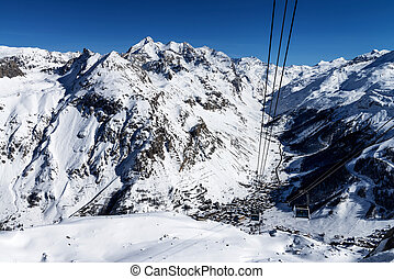 Cablecar to Val d'Isere, Alps in winter, Tarentaise, France