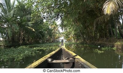 canoe boat on lagoons - The Kerala backwaters are a chain of...